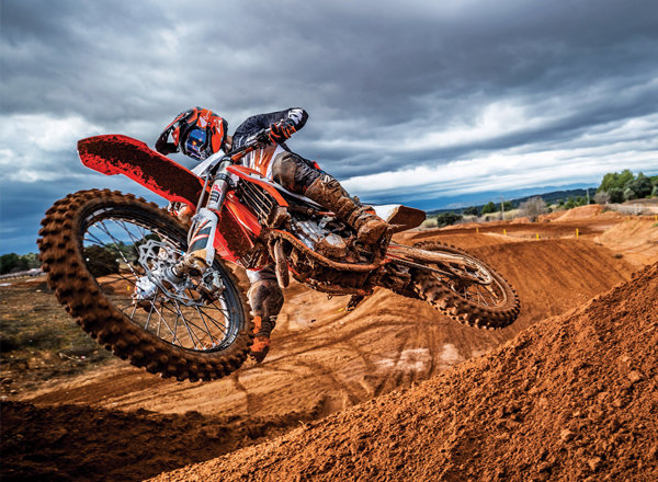 Action shot of motorcycle on dirt track